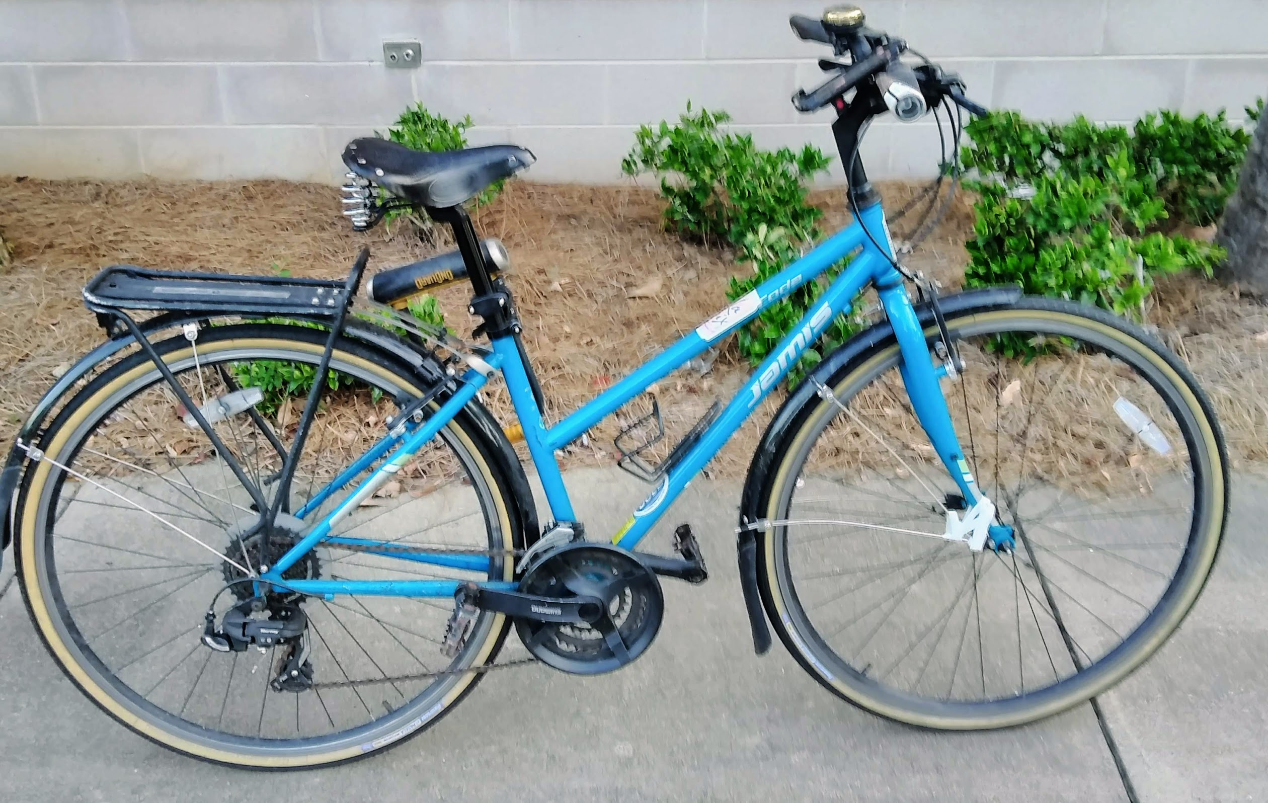 A blue hybrid bike with step-through frame